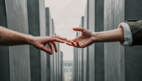 touching hands building to building