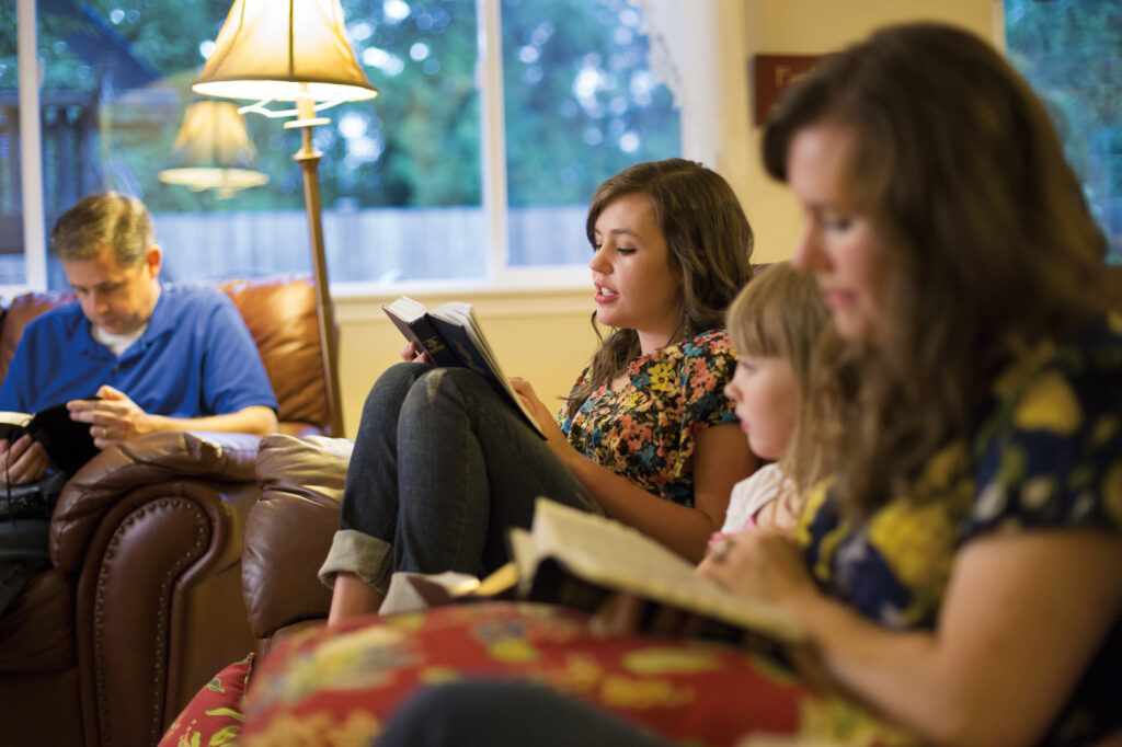 family reading Book of Mormon