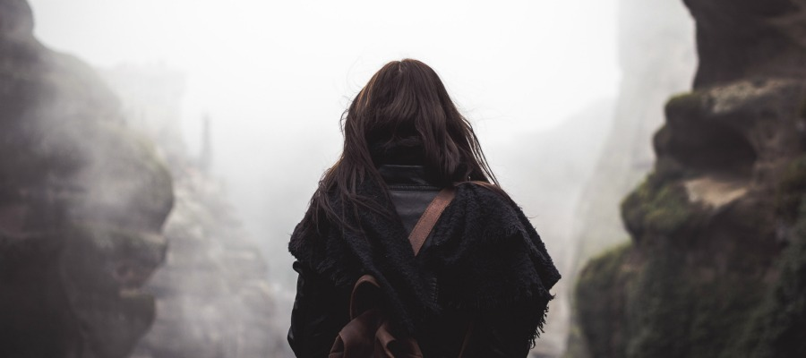 Woman walking through fog.