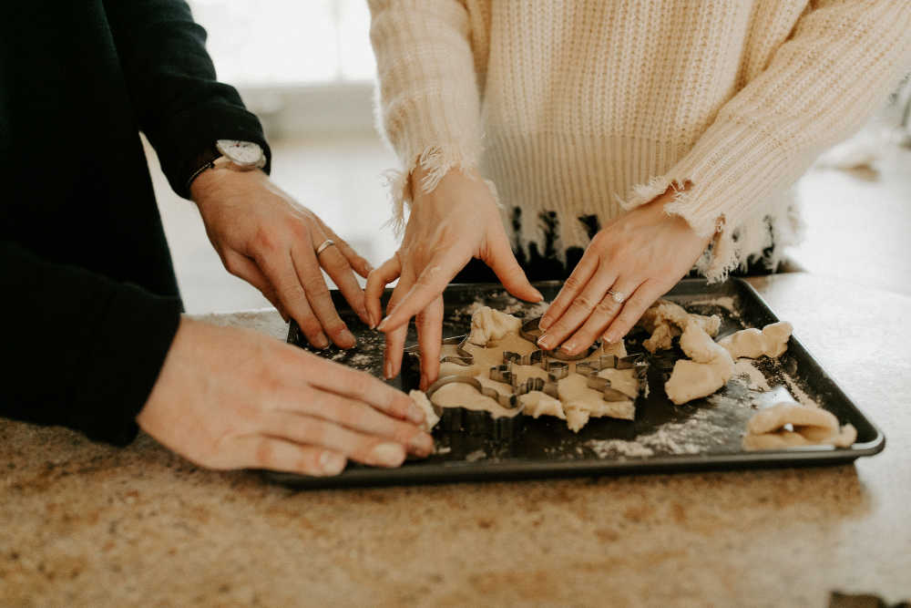 couple baking cookies together in marriage
