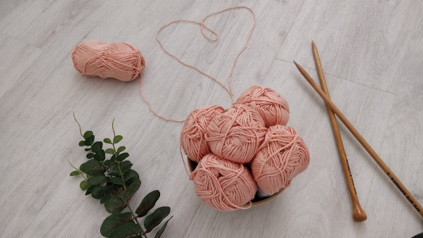 Pink Yarn balls and knitting cables
