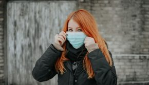 girl holding up medical mask