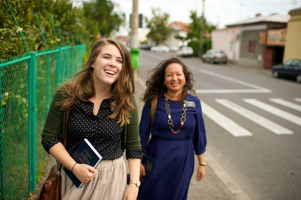 sister missionaries laughing together