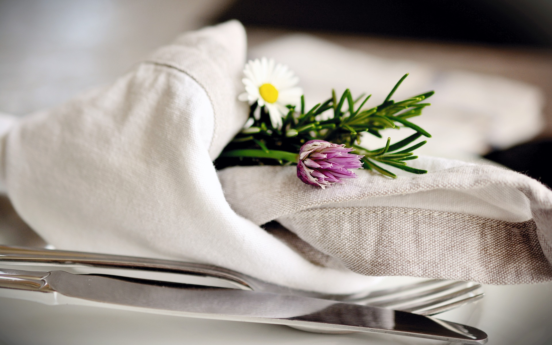 Cloth napkin and cutlery on a table.