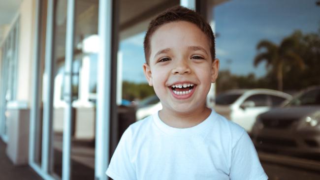 toddler boy smiling at the camera
