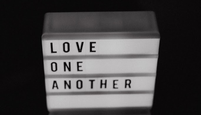 sign that says to love one another