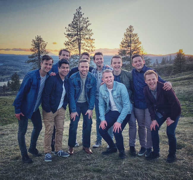byu vocal point standing with peter hollens smiling