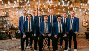 byu vocal point dressed in blue with lights