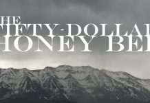 fifty-dollar honey bee text with mountains in background
