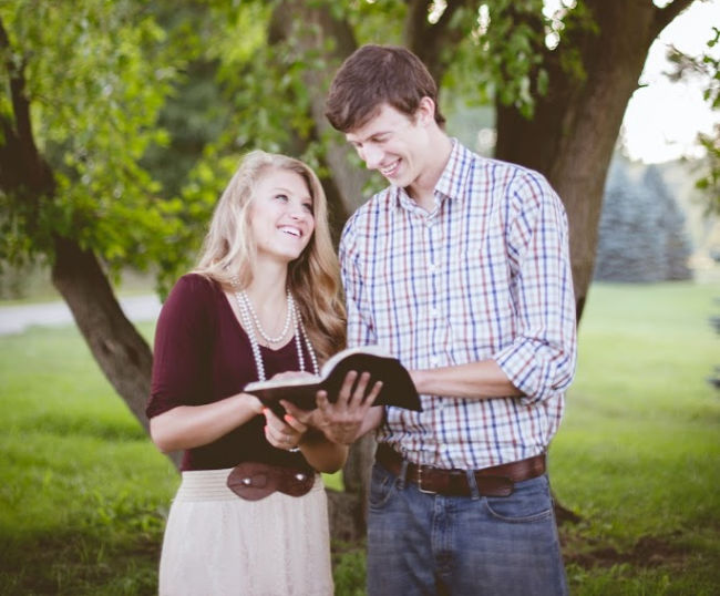 young adults reading scriptures together