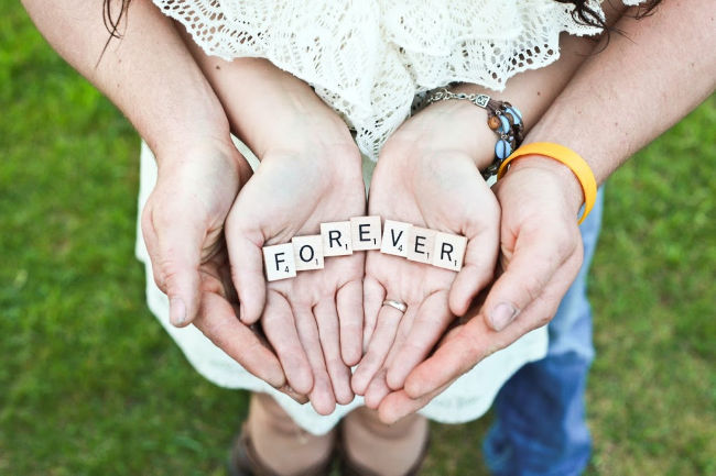 couple holding forever letters in their hands