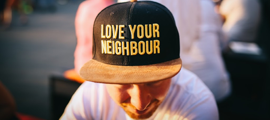 "Hat with words, ""Love your neighbour"""