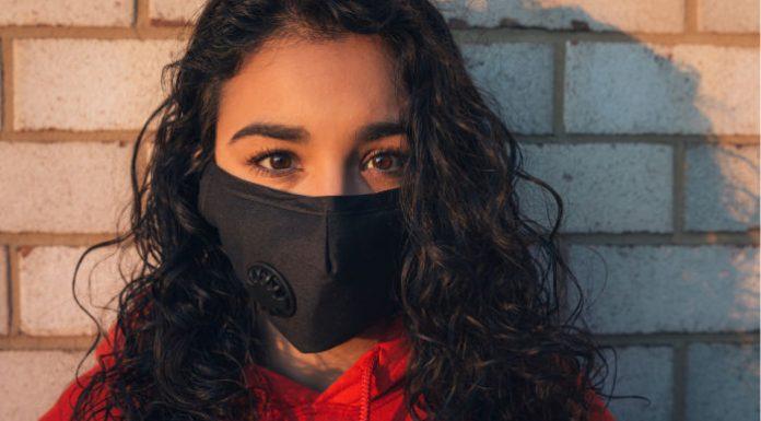 school girl in face mask