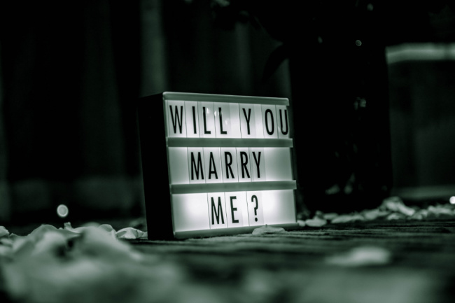 sign asking will you marry me wedding proposal