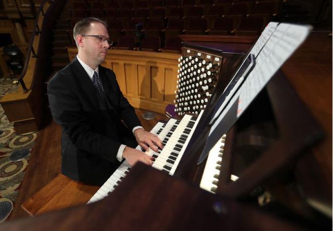 man playing keys on the organ