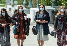 four sister missionaries serving a mission during COVID-19 wearing masks