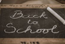 chalkboard that says back to school written on it