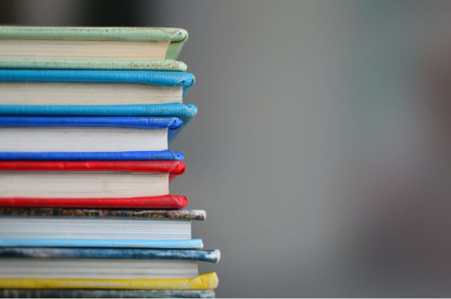 stack of books sitting and have multiple colors