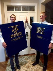 two people dressed at the book of mormon and bible costume for halloween