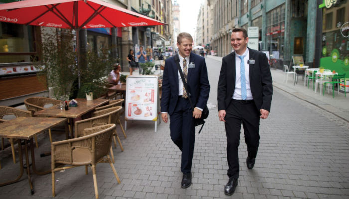 two elder missionaries walking down the street talking
