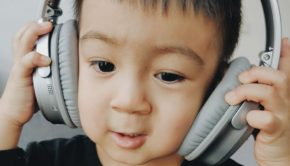 young boy wearing big headphones