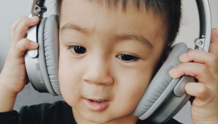 young boy wearing big headphones