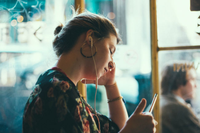 woman listening to latter-day saint podcasts