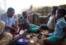 family from south africa playing a game together for family home evening