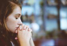 A woman prays.