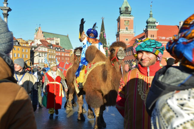 three kings day being celebrated with men riding camels