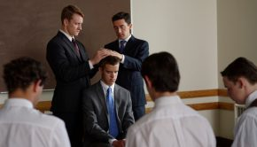 A young man is ordained to an office in the Aaronic priesthood.