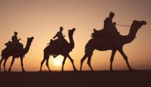 three wise men riding on camels for three kings day