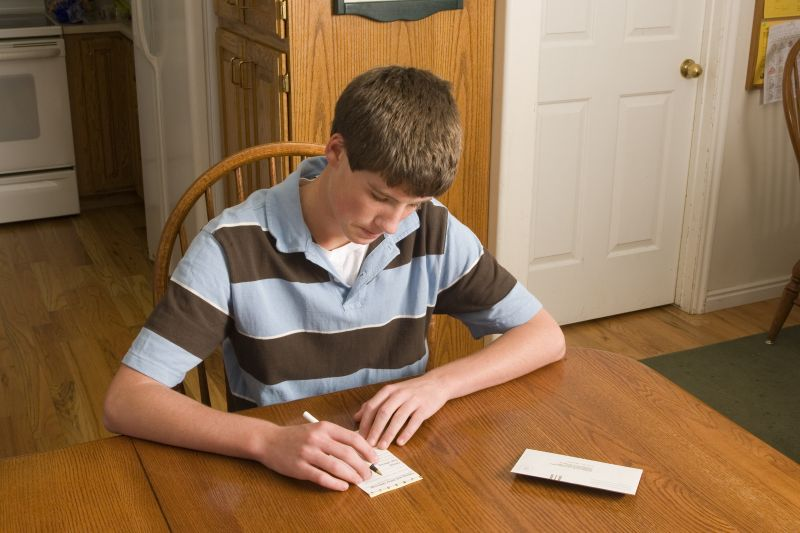 A young man fills out a tithing slip. Obedience to the commandments of God qualifies us to receive His blessings.